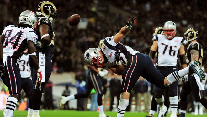 Patriots TE Rob Gronkowski spikes the football with authority after scoring against the Rams on Sunday.