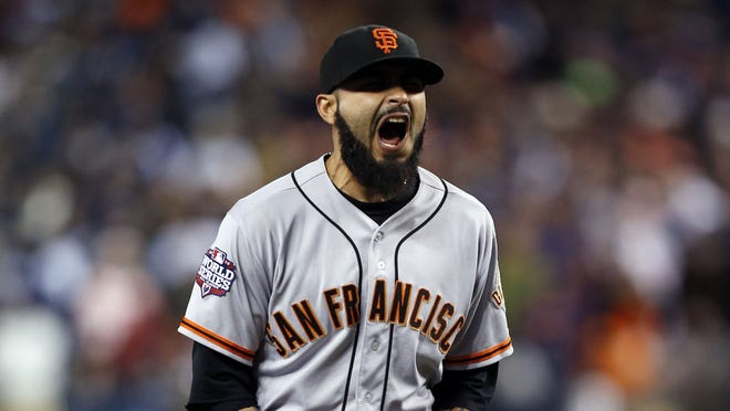 Sergio Romo reacts after defeating the Tigers in Game 3.