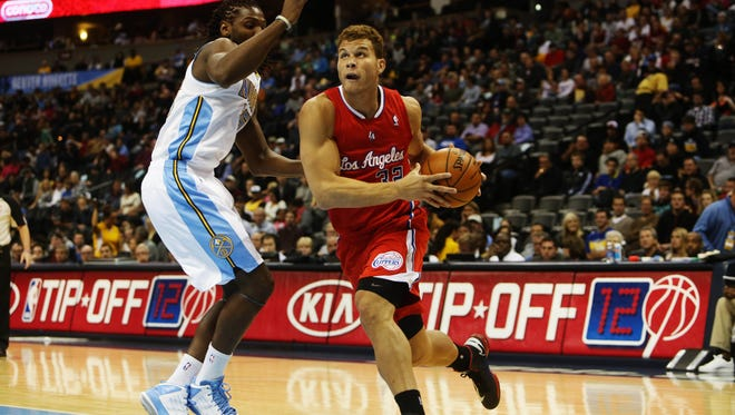 Clippers forward Blake Griffin (32) drives to the basket during the first half against the Denver Nuggets during the preseason.