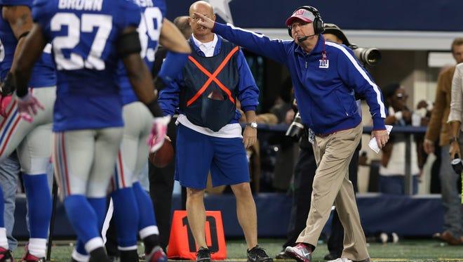 New York Giants head coach Tom Coughlin argues a call in the fourth quarter against the Dallas Cowboys at Cowboys Stadium.