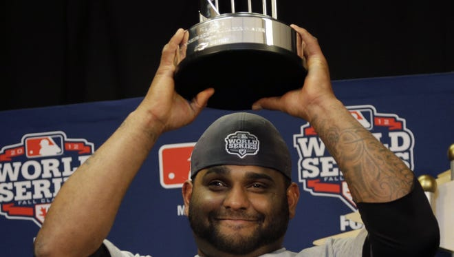 San Francisco Giants third baseman Pablo Sandoval hoists the MVP trophy after game four of the 2012 World Series against the Detroit Tigers.