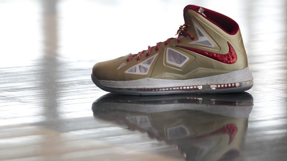 3b7ad49d2fdd LeBron James is wearing gold Nike shoes for NBA season opener