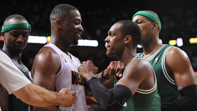 Celtics guard Rajon Rondo, right, and Heat guard Dwyane Wade squared off after a hard foul by Rondo in Tuesday's season opener, a 120-107 Heat win.