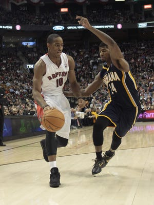 Raptors guard DeMar DeRozan drives around Pacers guard Paul George in Wednesday's 90-88 Indiana win.