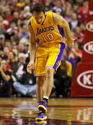 Lakers guard Steve Nash reacts to an injury in the first half of Wednesday's 116-106 loss after running into Blazers point guard Damian Lillard.