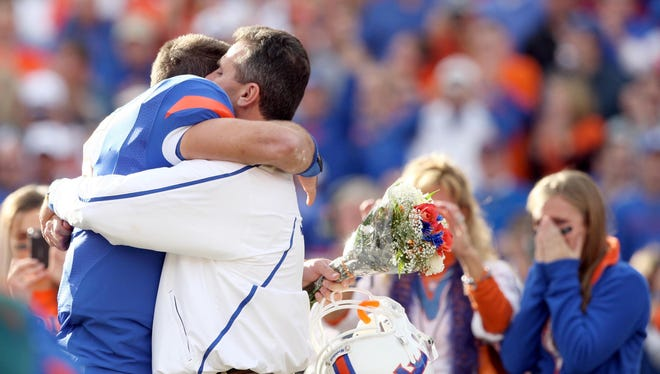 Florida quarterback Tim Tebow and coach Urban Meyer embrace before a game against Florida State on Nov. 28, 2009.