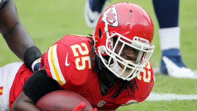 Kansas City Chiefs running back Jamaal Charles (25) looks up after being tackled during an NFL football game against the San Diego Chargers.