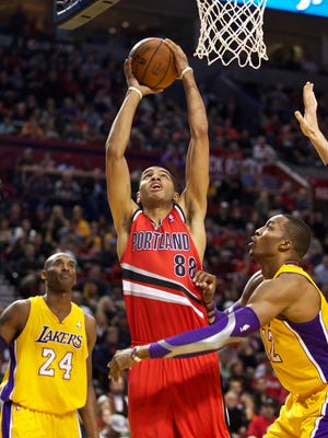 Blazers forward Nicolas Batum makes a layup in front of Howard. Batum also dunked on Howard in Portland's home win.