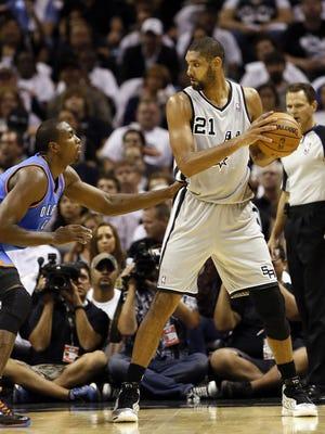 Spurs center Tim Duncan posts up Thunder forward Serge Ibaka on Thursday.