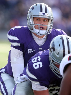 Kansas State quarterback Collin Klein takes a snap during the Wildcats' 55-24 win over Texas Tech on Oct 27.