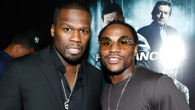 Curtis '50 Cent' Jackson and Floyd Mayweather Jr.  at the screening for the movie 'Freelancers' in August.  Their friendship and business relationship has ended, according to Jackson.