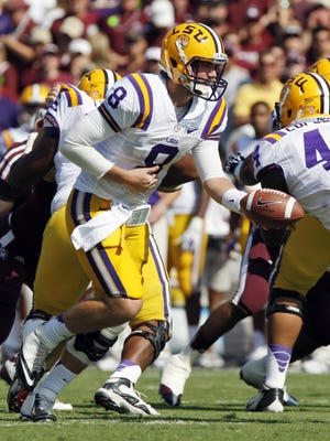LSU quarterback Zach Mettenberger hands off during a win over Texas A&M on Oct. 20.