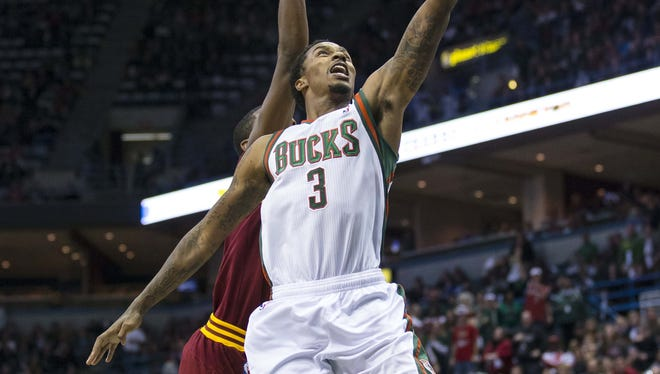 Milwaukee Bucks guard Brandon Jennings drives for a layup during the fourth quarter against the Cleveland Cavaliers at the BMO Harris Bradley Center.