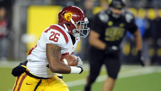 USC running back Marc Tyler carried the ball in the first half of last November's game between the Trojans and Oregon.