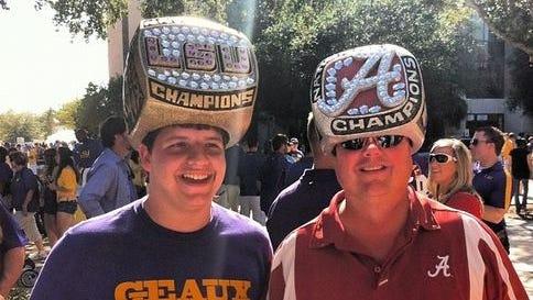 A pair of college football fans enjoying the pregame festivities at LSU-Alabama.