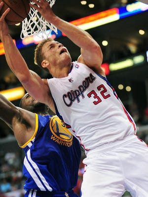 Los Angeles Clippers power forward Blake Griffin is fouled on a scoring play against the Golden State Warriors during the second half at Staples Center.