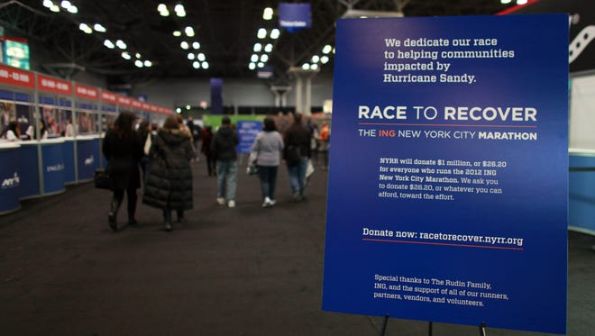 Donation sign is seen during New York City Marathon runner check in at the Javits Center November 3, 2012 in New York City.