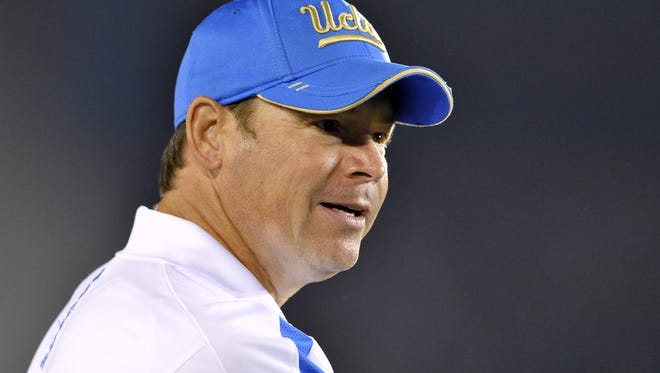 "UCLA coach Jim Mora reacts to a call during UCLA""s win over Arizona on Nov. 3"