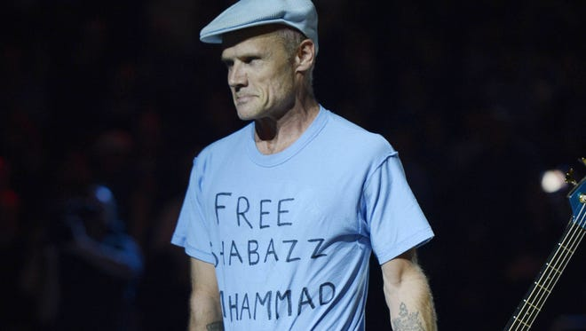 Flea shows off his Shabazz Muhammad shirt at the UCLA game.