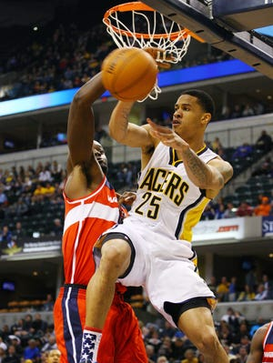 Pacers forward Gerald Green makes a pass around Wizards center Emeka Okafor in Saturday's 89-85 win.