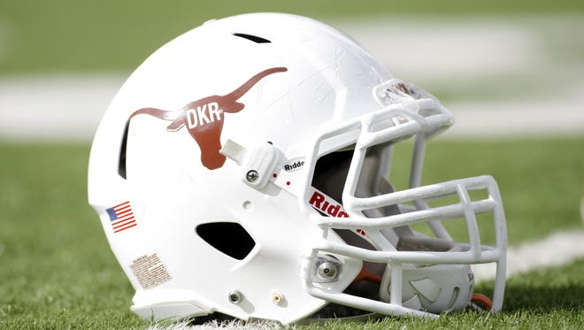 """The helmet used by Texas for today's game against Iowa State features a """"DKR"""" decal in honor of former head coach Darrell Royal."""