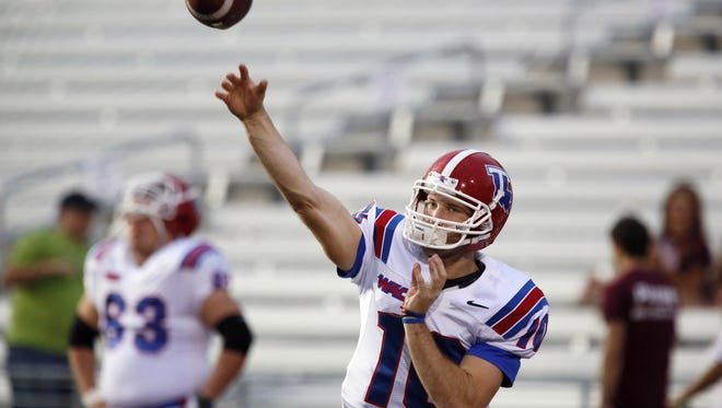 Louisiana Tech quarterback Colby Cameron warms up before a game against Texas State.