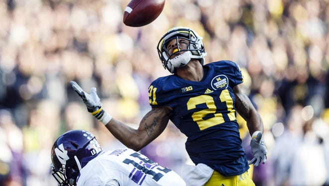 Michigan wide receiver Roy Roundtree's 53-yard catch helped Michigan beat Northwestern in overtime.