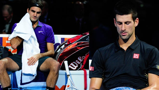 Roger Federer and Novak Djokovic during changeovers at the ATP World Tour Finals