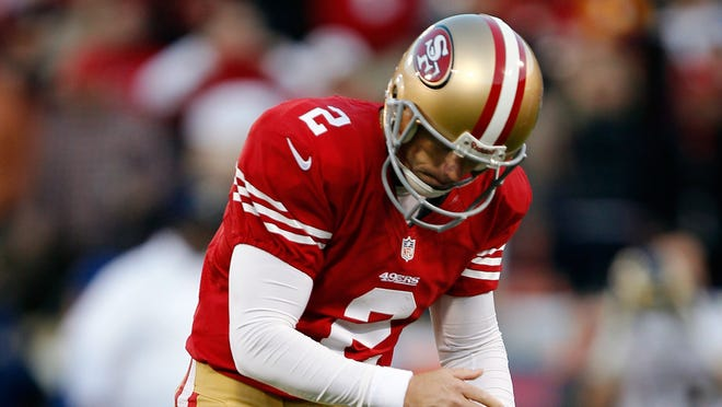 David Akers can't compute his missed field goal attempt in overtime.
