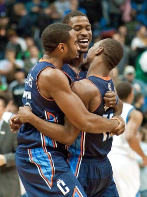 Kemba Walker, right, is hugged by Bobcats teammates after he beat the Timberwolves 89-87 Wednesday with a jump shot in the final second.