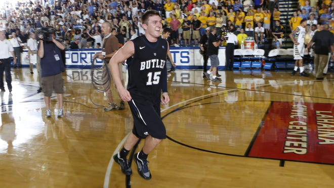 Rotnei Clark runs off the floor after making the game-winning shot at the buzzer to defeat the Marquette Warriors.