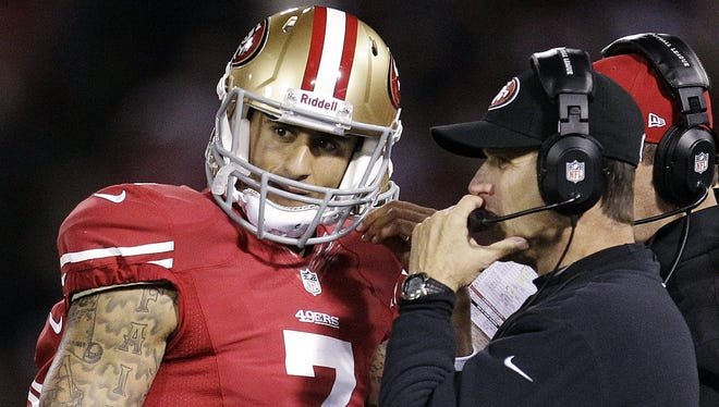 49ers quarterback Colin Kaepernick (7) talks with head coach Jim Harbaugh during Monday night's win over the Bears. Will the starting job be Kaepernick's now after his stellar performance?