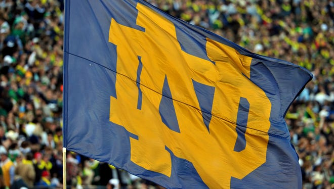 A Notre Dame flag waves in the first quarter of the game between the Notre Dame Fighting Irish and the Wake Forest Demon Deacons at Notre Dame Stadium. Notre Dame won 38-0.