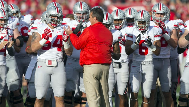 Ohio State coach Urban Meyer, firing up his  team before a game against Wisconsin on Nov. 17,  gains income from a deal with the Kroger supermarket chain.