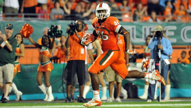 Miami (Fla.) tight end Clive Walford scores a touchdown during the Hurricanes' win over South Florida on Nov. 17.
