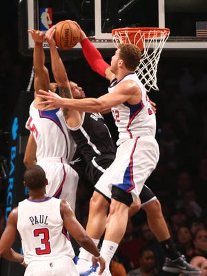 Los Angeles Clippers power forward Blake Griffin (32) blocks a shot by Brooklyn Nets point guard Deron Williams (8) during the first half at the Barclays Center.