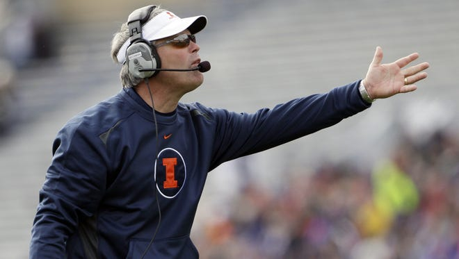 Illinois coach Tim Beckman reacts to a call during the first half of Saturday's game against Northwestern