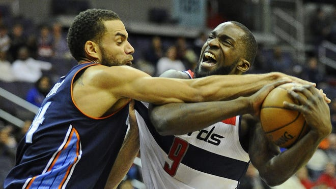 Wizards forward Martell Webster is fouled by Bobcats forward Jeffery Taylor in Saturday's 108-106 Charlotte double-overtime win.