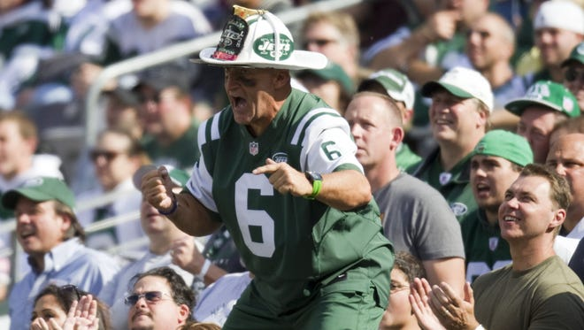 """Fireman Ed, a fixture at Jets games, leads his signature """"J-E-T-S, Jets, Jets Jets!"""" chant earlier this season. Is he done, though?"""