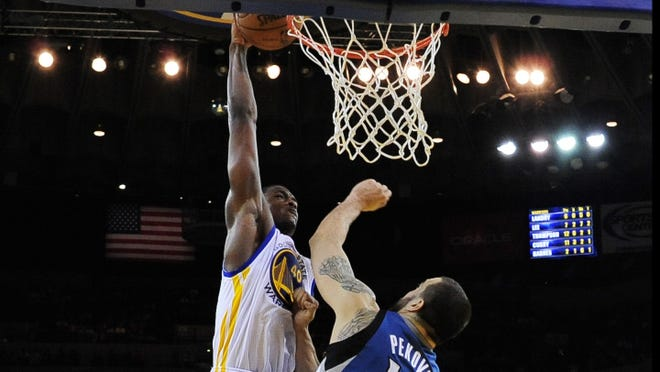 Harrison Barnes dunks over Minnesota Timberwolves center Nikola Pekovic during the second quarter at ORACLE Arena. Coming to a poster near you.