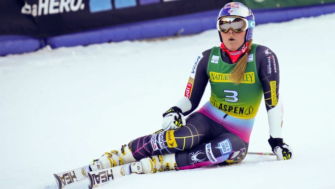 Lindsey Vonn of the United States, collapses in the finish area after her second run in the women's World Cup giant slalom in Aspen, Colo., on Saturday.