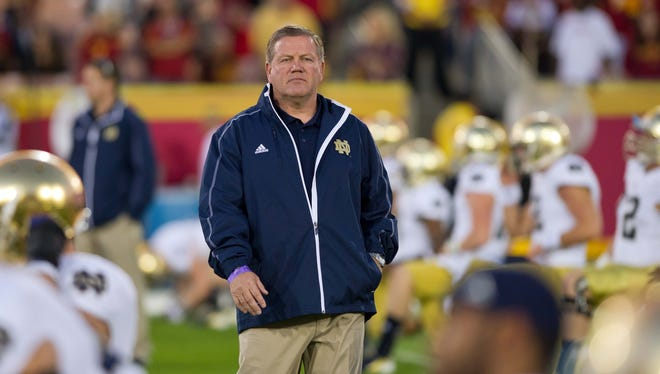 Notre Dame coach Brian Kelly leads the 12-0 Fighting Irish into a date with either Alabama or Georgia in the BCS championship game.