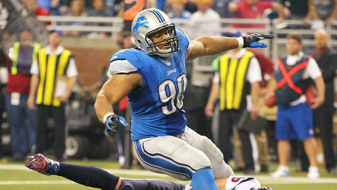 Detroit Lions defensive tackle Ndamukong Suh knocks down Houston Texans quarterback Matt Schaub in one of the less controversial hits of their Thanksgiving matchup.