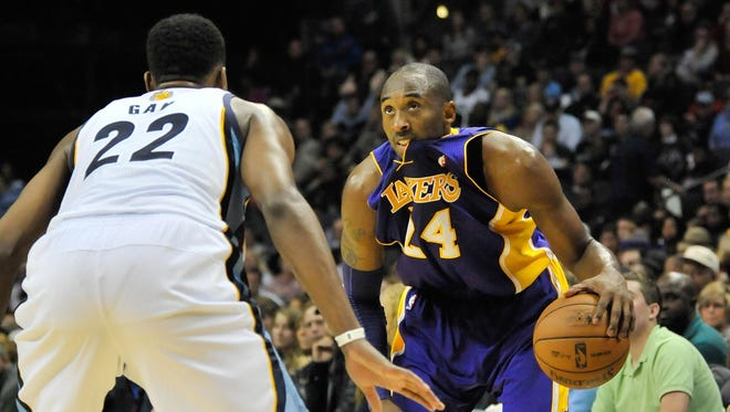 Los Angeles Lakers shooting guard Kobe Bryant (24) looks to drive against Memphis Grizzlies small forward Rudy Gay (22) during the second quarter at Fed Ex Forum.