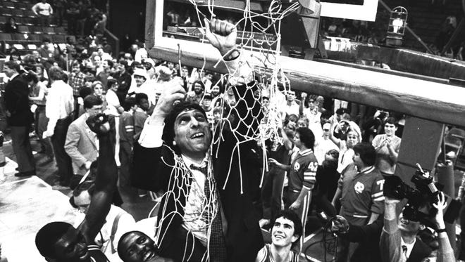 N.C. State basketball coach Jim Valvano cuts down the net, March 13, 1983, after his Wolfpack beat Virginia, 81-78, for the championship of the Atlantic Coast Conference at the Atlanta Omni.