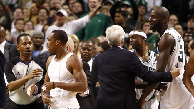 Celtics players, including Kevin Garnett, right, and Rajon Rondo, second from left, are separated from Nets players after an altercation Wednesday.