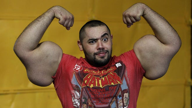 In this photo taken, Friday, Nov. 16, 2012, Egyptian Body builder Moustafa Ismail poses during his daily workout at World Gym.