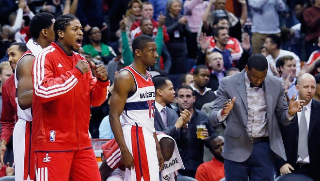 From left: Cartier Martin #20 (L) Jordan Crawford #15 and John Wall #2 (R)of the Washington Wizards celebrate on the bench during the closing moments of the Wizards 84-82 win over the Portland Trail Blazers at Verizon Center on November 28, 2012 in Washington, DC. NOTE TO USER: User expressly acknowledges and agrees that, by downloading and or using this photograph, User is consenting to the terms and conditions of the Getty Images License Agreement.  (Photo by Rob Carr/Getty Images) ORG XMIT: 152060977 ORIG FILE ID: 157146571