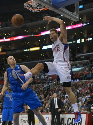 Clippers forward Blake Griffin dunks in front of Mavericks center Chris Kaman during Wednesday's win.