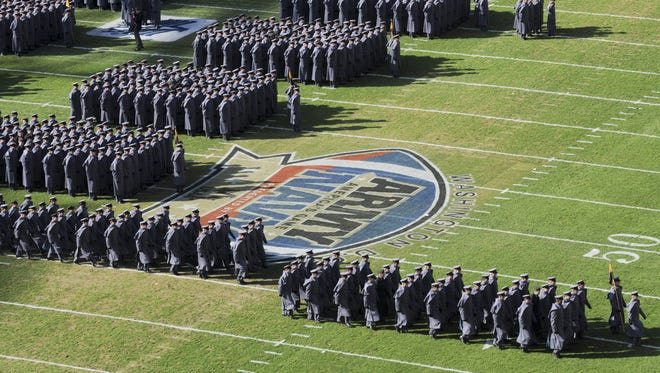 Army cadets march onto the field before the Army-Navy game on Dec. 10, 2011.